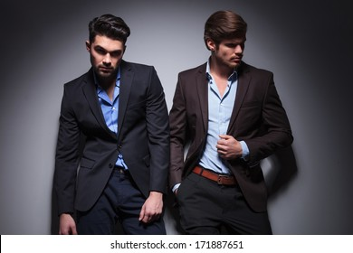 pair of male models posing in studio, one looking at the camera, one looking away