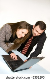 Pair of managers communicating, working on laptop computer
