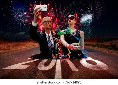 pair of mannequins takes a selfie celebrating New Year's Eve in the street under the fireworks