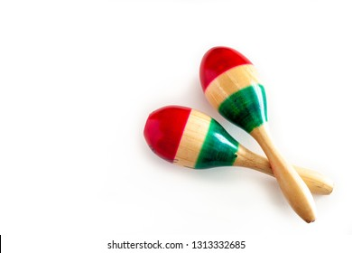 Pair of maracas painted in the colors of the Mexican flag on white background. Cinco de mayo background concept