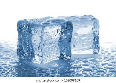 Pair of melted ice cubes with water drops on white background