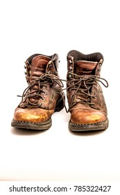 Pair of Men's Dirty Beat Up Brown Leather Work Boots with Long Laces Isolated on White Background
