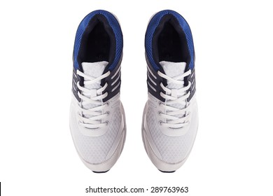 Pair of men's white sneakers on a white background, top view