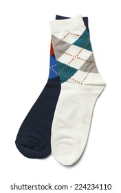 Pair of Mismatched Blue and White Socks Isolated on White Background.