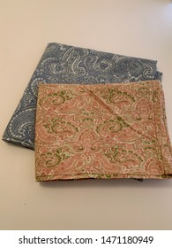 Pair of mismatched pillowcases with paisley design