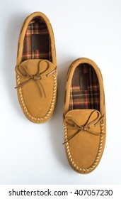 Pair of Moccasin Slippers Top View Staggered