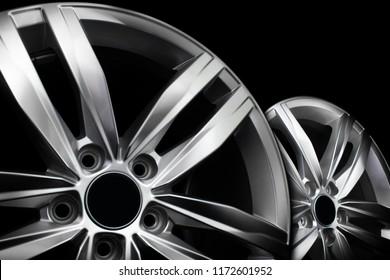 Pair of modern aluminium wheel rims isolated on black background.
