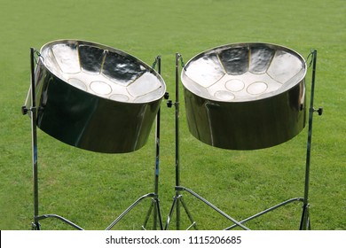 A Pair of Musical Metal Steel Drums on Stands.