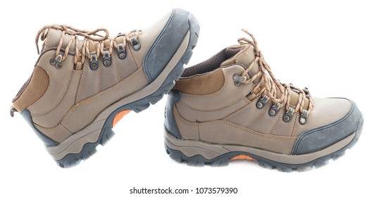pair of new fashion men's trekking boots, isolated on white backgroud