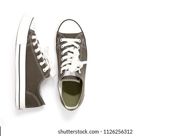 Pair of new green , gray sneakers isolated on white background.