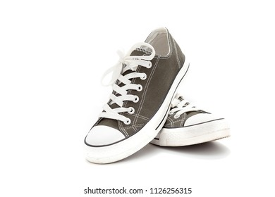 Pair of new green sneakers isolated on white background.