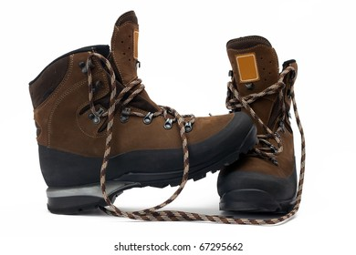 A pair of new hiking boots on white background
