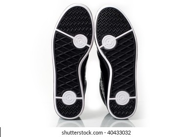 A pair of new sport sneakers isolated. Bottom perspective