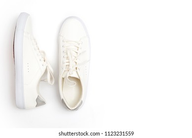 Pair of new white sneakers on white background.