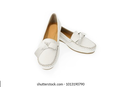Pair of off-white classic women's slip-on loafer shoes with trim and bow to front. Made of genuine leather.Isolated on white background.Easy to use.