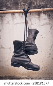 pair of  old boot hang on bamboo, process color
