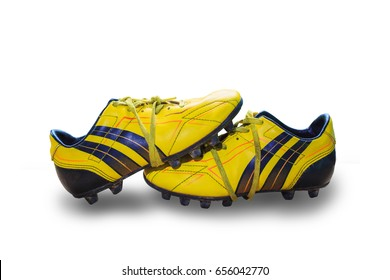 f9fef7ea5 A pair of old football boots old yellow football shoes placed Isolate on  white background