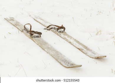 Pair of old skis on the snow