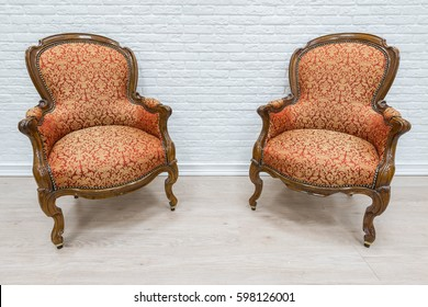 Pair Of Old Vintage Luxury Armchairs On The White Wall Background.
