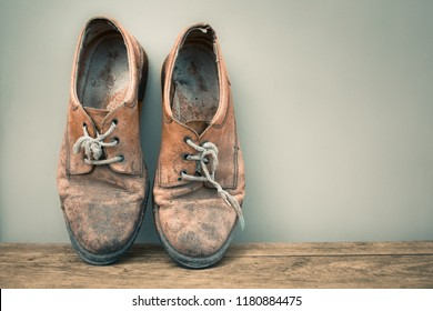 Pair of old weathered leather shoes isolated.