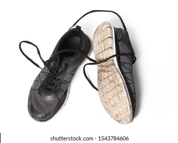Pair of old women's sneakers isolated on a white background. Concept for everyday shoes.