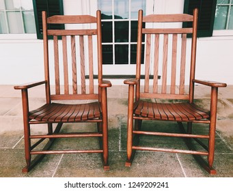 A pair of old wooden rocking chairs on the porch of Hill–Stead Museum house in Farmington, Connecticut, United States.