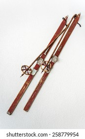 Pair of old wooden skis on white background