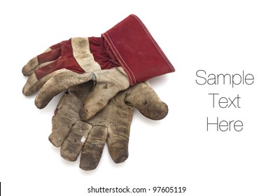 Pair of old work gloves on white background with soft shadow