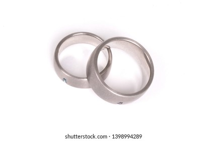 Pair of paladium wedding rings isolated on white background