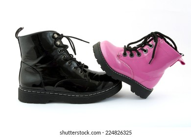 A pair of pink children's shoes.