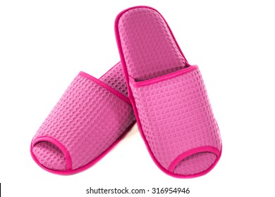 A pair of pink slippers on a white background.