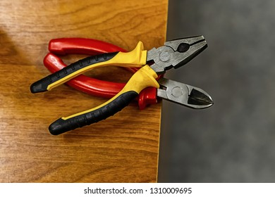 pair of pliers bright handles plastic yellow red working hand tools