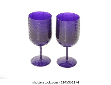 A pair of purple Halloween goblets standing side by side with a spider web pattern on them. Taken in the studio with a white background. Space for text.