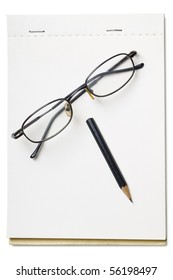 a pair of reading glasses and black pencil on a blank pad
