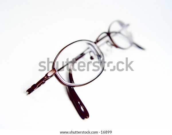 Pair of reading glasses isolated on white background