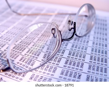 Pair of reading glasses on business book, taken closeup