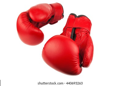 pair of red boxing gloves on white background
