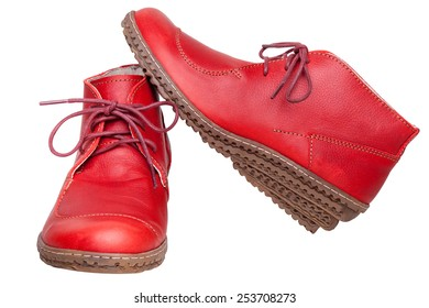 Pair red female boots on a white background with clipping paths