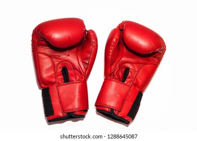 A pair of red gloves for boxing on a white background