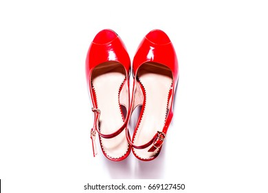 A pair of red high heels shoes view on top . Isolated on white background. Modern concept of fashion, beauty, style, trend. Women's shoes.