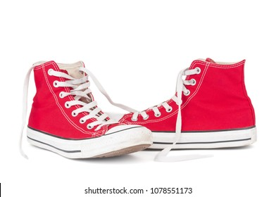 Pair red sneakers on white background