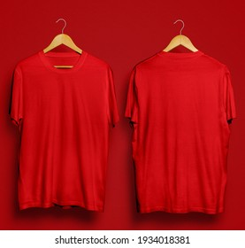 a pair of red t-shirts made of cotton on a red background