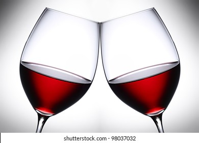 a pair of red wine glasses