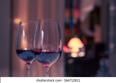 Pair of red wine glasses, closeup shot