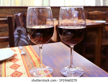 Pair of red wine on the wooden table