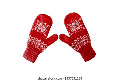 pair of reds knitted mittens with christmas pattern isolated on