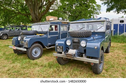 A pair of restored Landrovers from the 1950's being exhibited together at the Strathmore Vintage Vehicle Extravaganza in the grounds of Glamis Castle.