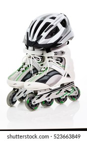 A pair of roller skates with helmet on a white background