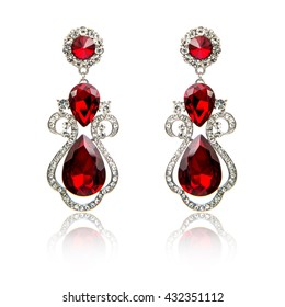 Pair of ruby diamond earrings isolated on white