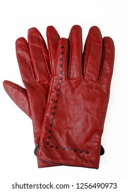 Pair of rusty red colored gloves on white.